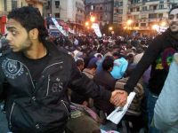 Muslims and Christians United in the Battle for Tahrir Square