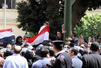 Broken arm sees protest put down by Egypt police