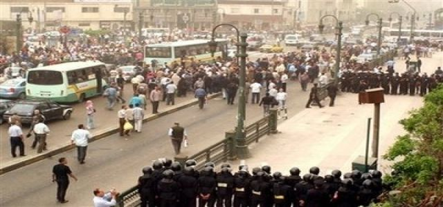Strike Turns Egypt 's Main Squares into Military Barracks, Detentions Underway