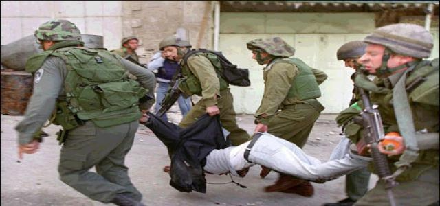 IOF troops violently quell march, break hand of Palestinian youth