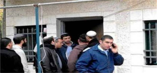 Guarded Israeli settlers seize new house in Jerusalem neighborhood